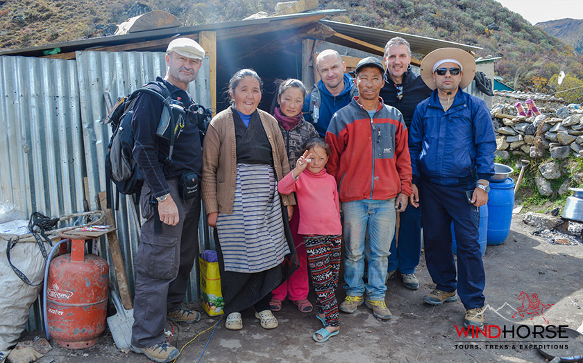 Tourist taking Photograph with the local community people after interacting & visiting the local Sherpa people