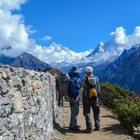Trekkers looking the Everest range and Aama Deblam mountain range from Shyangboche